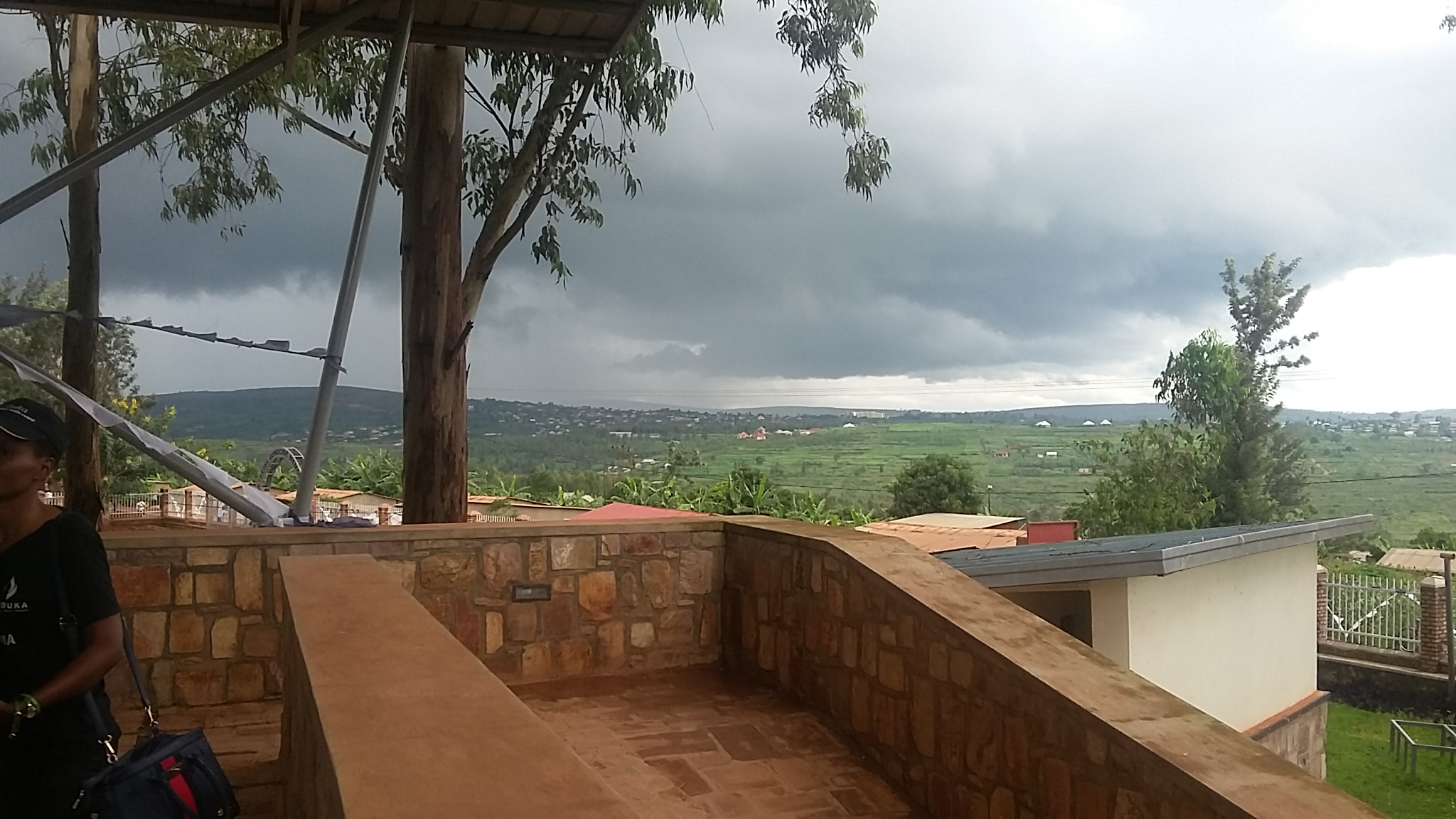 A view of rural Rwanda on a cloudy day at Ntarama